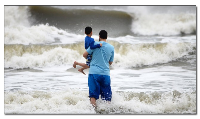 Father saves son from Hurricane Sandy.